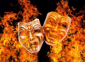 Comedy and Tragedy theatrical venetian mask burning