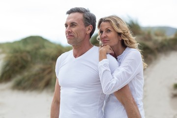 Mature couple standing together on the beach