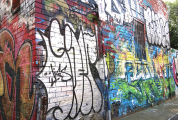 MELBOURNE, AUSTRALIA - May 27, 2015: Colourful street art on the wall of a building in a Fitzroy alleyway