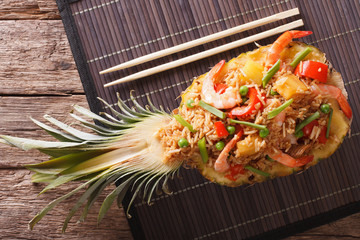 Thai pineapple stuffed with rice, shrimp, chicken and vegetables close-up. horizontal top view
