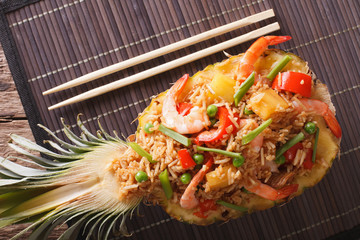 Thai food: fried rice with shrimp, chicken and pineapple close-up. horizontal top view