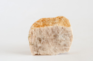 Piece of orthoclase ore on white background