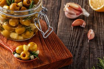 Fresh olives with rosemary, garlic, lemon.