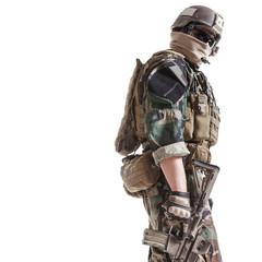 United states Marine Corps special operations command Marsoc raider with weapon. Studio shot of Marine Special Operator white background turning around