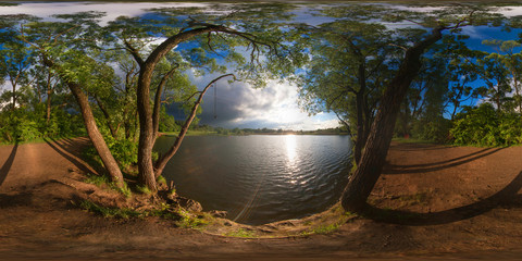 Full 360 degree equirectangula panorama forest lake at sunset