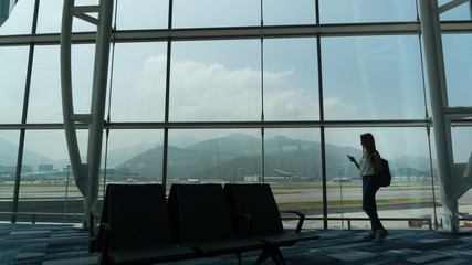 Girl at the airport window