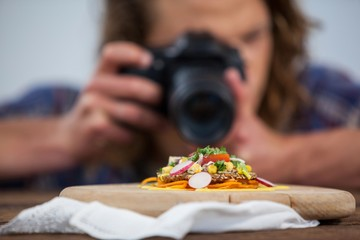Male photographer photographing food