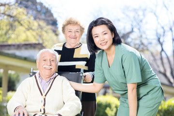 Asian nurse smiling with elderly people with physical problems o