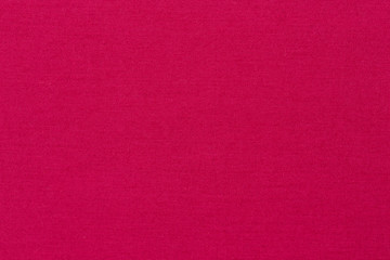 Plain pink fabric texture background.