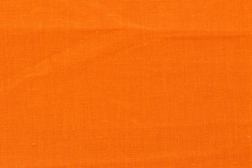 Orange fabric texture for background.