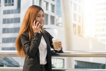 businesswoman using her smartphone