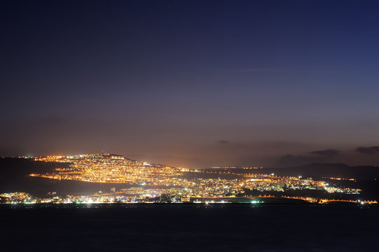 Tiberias city lights late at night on the Sea of Galilee