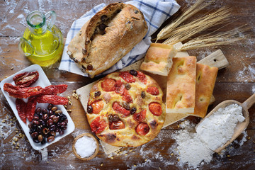 Focaccia with cherry tomatoes and olives, olive bread, white focaccia, dried tomatoes and olives