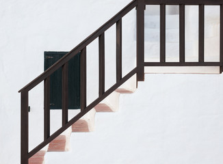 Staircase in white facade