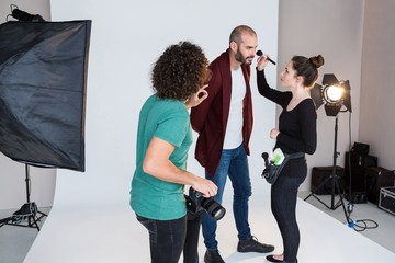 Male model preparing for a photo shoot