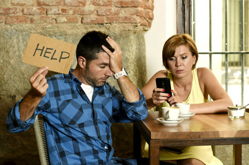 couple at coffee shop  mobile phone addict woman ignoring frustrated man asking for help