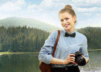 Photographer on beautiful landscape background