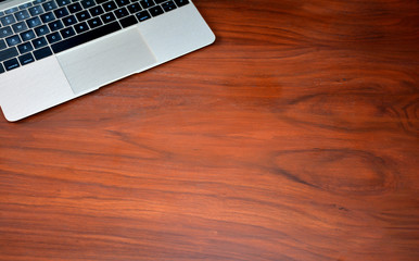 Laptop on Office Wooden Table Background with copy space
