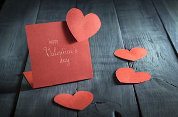 Card Happy Valentine's Day in the old wooden background.