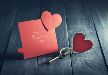 Valentine's Day card with a key and paper hearts.