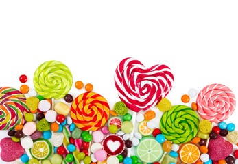 Wall Mural - Colorful candies and lollipops. Top view.