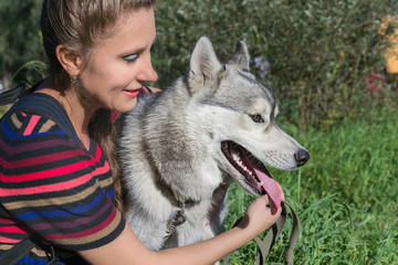 Husky dog and attractive woman enjoying the nature