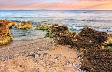 sea waves running on sandy beach