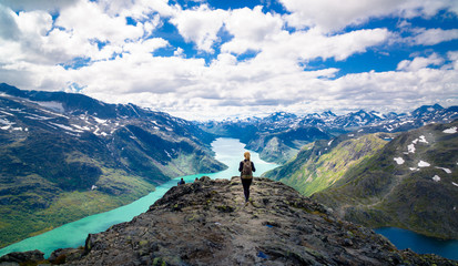 Young woman hiking in the mountains. Besseggen, Jotunheimen, Norway Wall mural