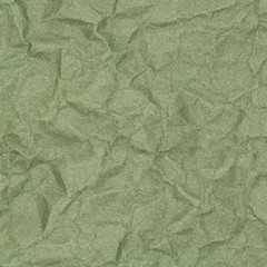 abstract background of crumpled green paper with blotches