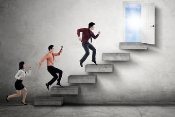 Businesspeople compete to reach door