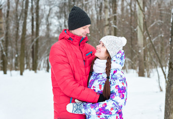love couple smiles in winter park