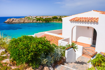 Fototapete - Typical holiday villa in beautiful bay of Arenal d'en Castell, Menorca island, Spain