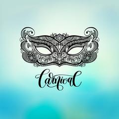 black lineart venetian carnival mask silhouette on blured backgr