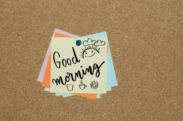 Good morning handwritten message on piece of paper with smiling sun
