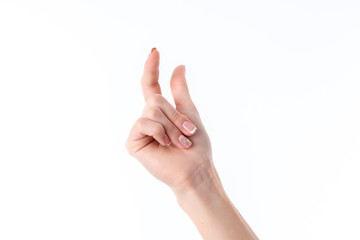 female hand showing the gesture with raised up the index finger and thumb