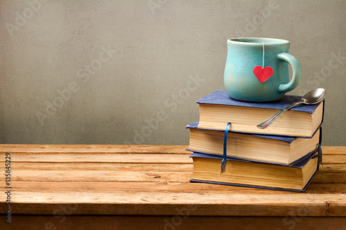 Valentines day holiday concept with tea cup and books on for Table 52 valentine s day