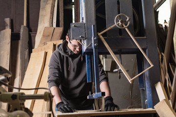 Carpenter working on a saw machine