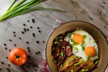 Ukrainian light breakfast. Breakfast in the pan on a wooden background