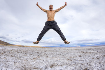 Crazy man leaping with joy