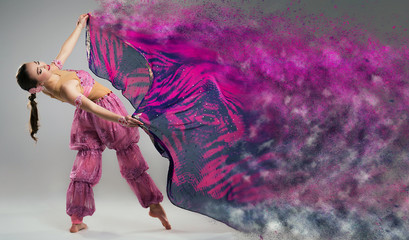 Dancer with disintegrating scarf. Abstract vision.Photo manipula