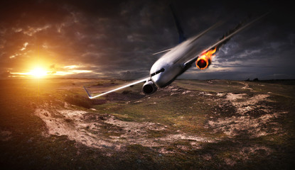 Plane with engine on fire about to crash