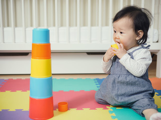 Cute baby girl playing  toys at home