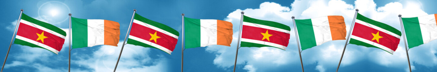 Suriname flag with Ireland flag, 3D rendering