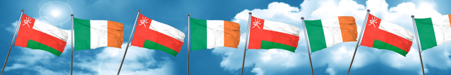 Oman flag with Ireland flag, 3D rendering