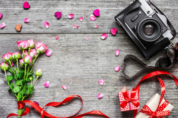 valentines day background. vintage retro camera with pink roses flower