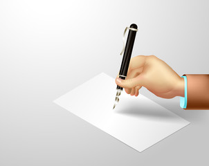 hand holding  pen over the blank paper on gray background