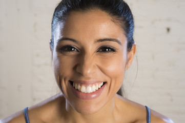 portrait of young beautiful and happy hispanic woman laughing