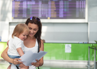 Young mother and her daughter at  airport