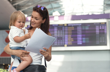 Young mother with daughter at airport