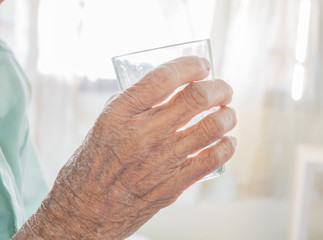 Water glass in old Hands
